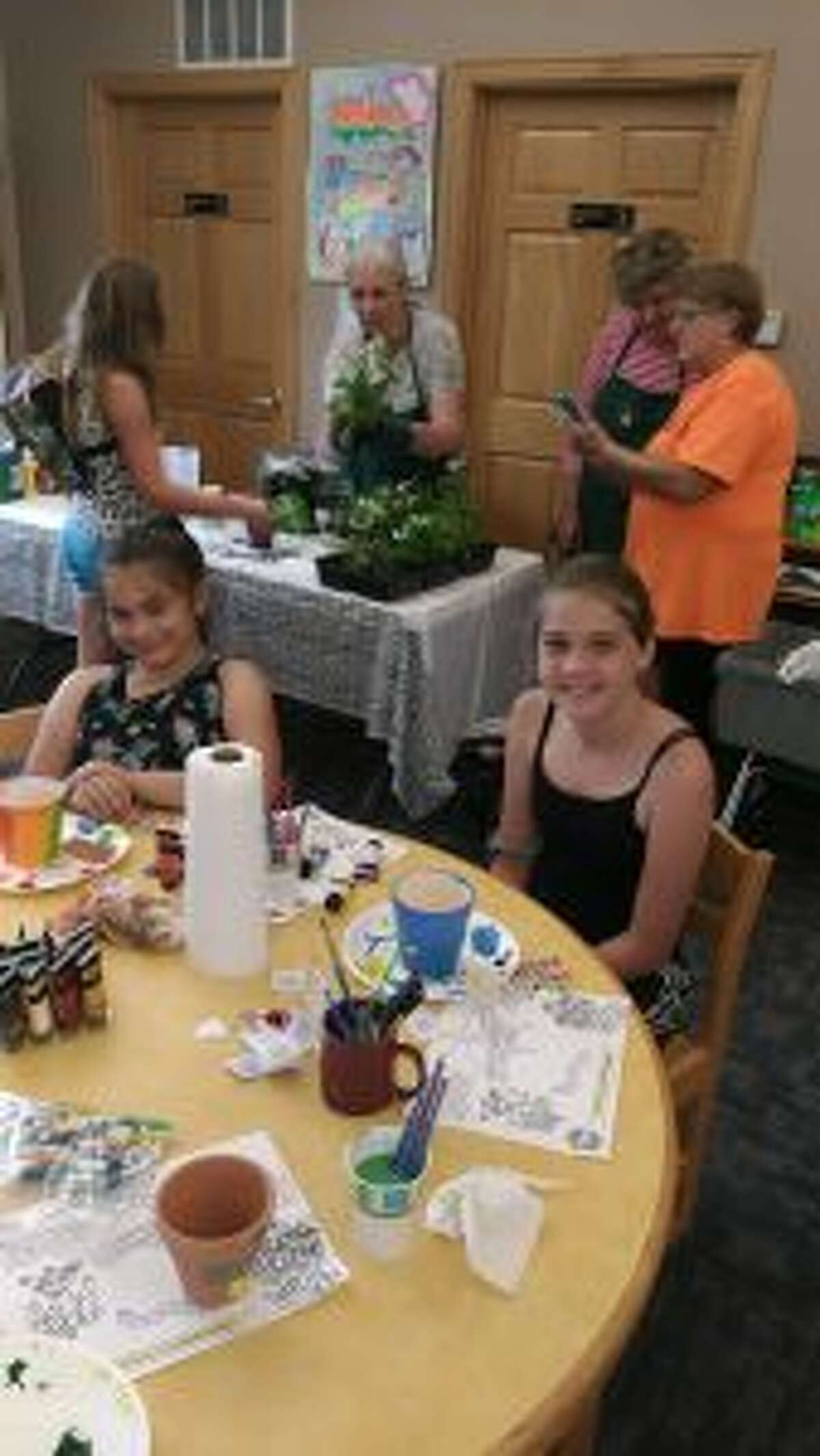 Spirit of the Woods Garden Club Inc. visited libraries throughout Manistee County last week. Children decorated flower pots and planted flowers in them. (Courtesy photo)