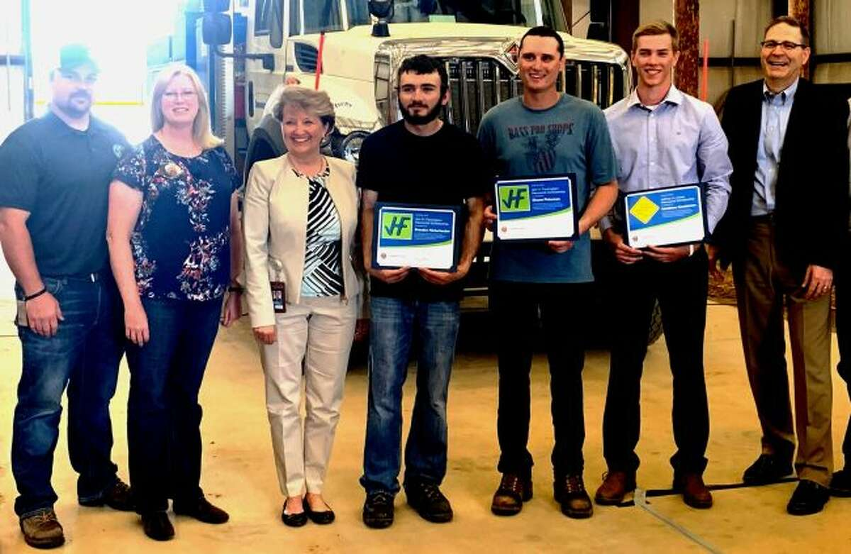 The Consumers Energy Foundation is assisting three individuals training to become electric lineworkers with scholarships honoring two fallen company linemen. Shown (left to right) are Michigan State Utility Workers Council representative Ben McCrumb, James Farrington's wife Mary Farrington, Consumers Energy Foundation's Carolyn Bloodworth, scholarship recipients Brandon Nickerbocker, Shane Peterson and Matthew Goodenow and Consumers Energy Vice President Guy Packard.