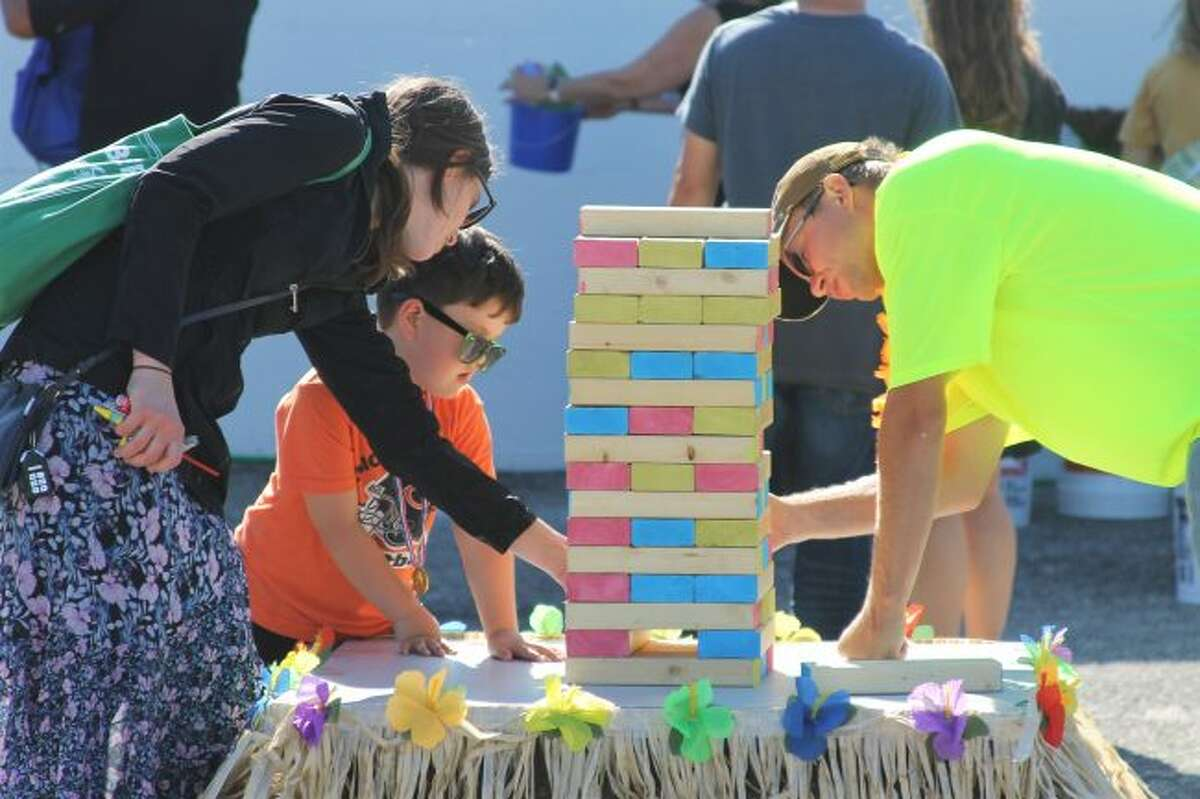 Families partake in games during the Onekama Block Party on Thursday afternoon. (Ashlyn Korienek/News Advocate)