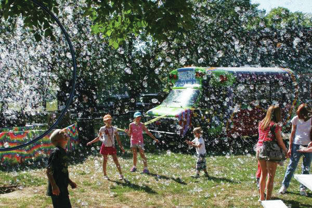 Youngsters enjoy thousands of bubbles from The Bubble Bus, which will be at the Midwest Salute to the Arts festival from 11 a.m. - 12 p.m., both Saturday, Aug. 24 & Sunday, Aug. 25.