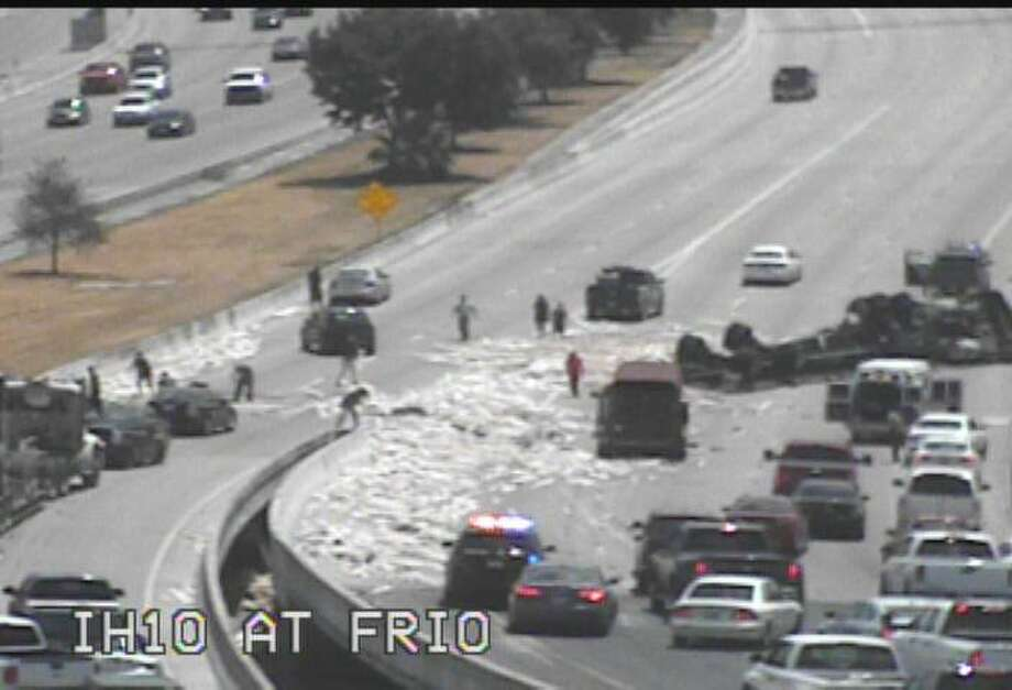 An overturned 18-wheeler carrying lumber shuts down the upper level eastbound of Interstate 10 near Frio Road, according to San Antonio Police Department. Photo: TxDOT