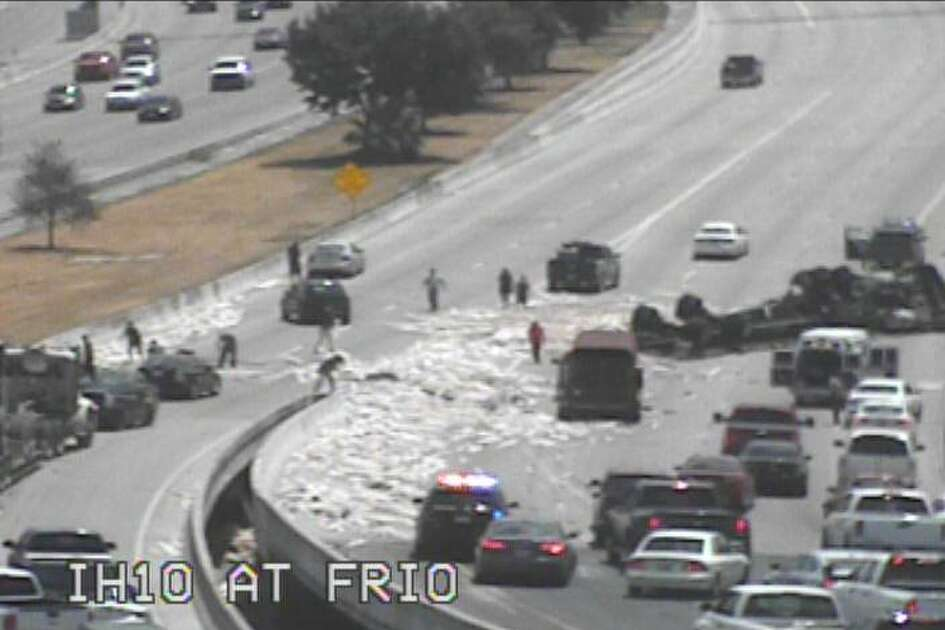 An overturned 18-wheeler carrying lumber shuts down the upper level eastbound of Interstate 10 near Frio Road, according to San Antonio Police Department.