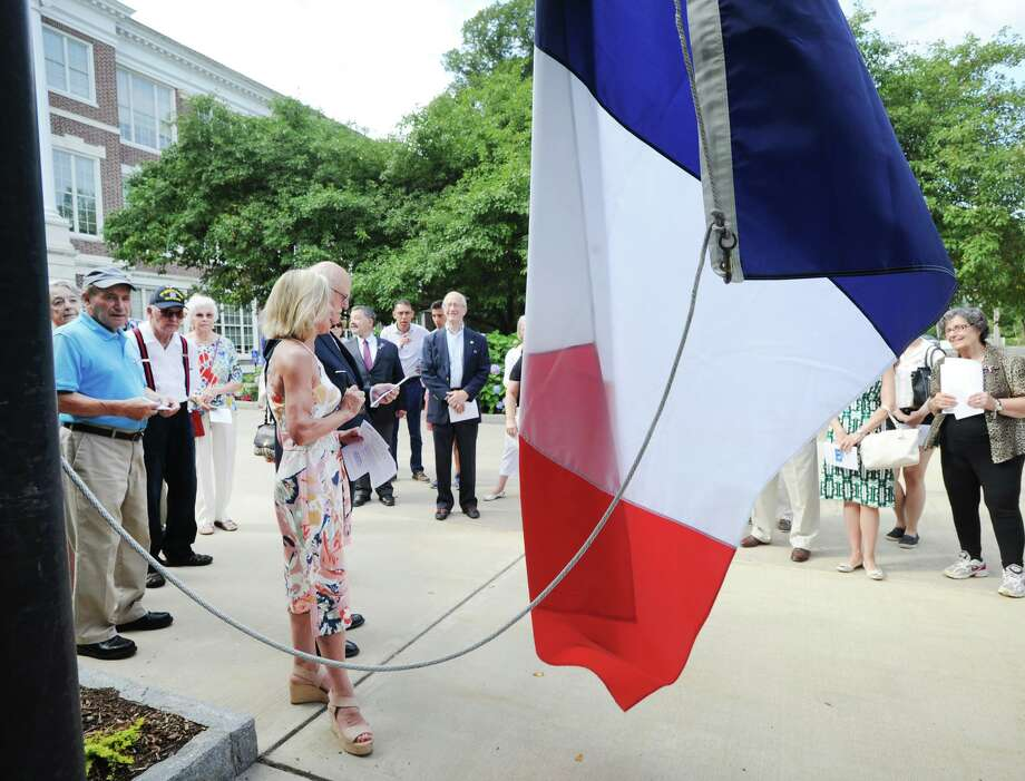 The Alliance Francaise of Greenwich annual Bastille Day French flag raising in front of Greenwich Town Hall, Conn., Saturday morning, July 14, 2018. Photo: File / Hearst Connecticut Media / Greenwich Time