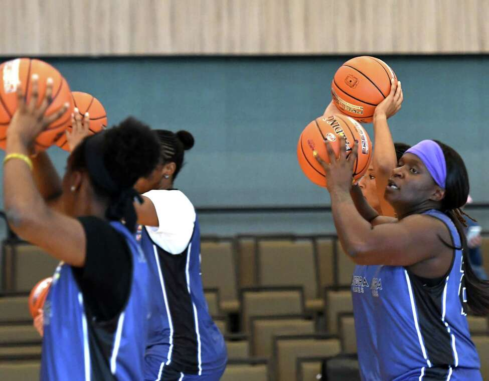 Former WNBA player Barbara Turner, right, works out with her Team Americas basketball squad teammates during practice for the Aurora Games on Wednesday, Aug. 21, 2019, at the Capital Center in Albany, N.Y. (Will Waldron/Times Union)