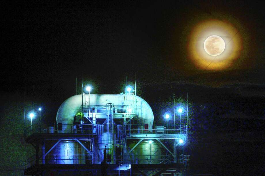 A large moon rises behind the Exxon Mobil plant in Beaumont Wednesday night. A trifecta of lunar occurrences took place early Wednesday morning - a super moon, blue moon and lunar eclipse converged for the first time in over a hundred years. Photo taken Wednesday, January 31, 2018 Kim Brent/The Enterprise Photo: Kim Brent / Beaumont Enterprise / BEN