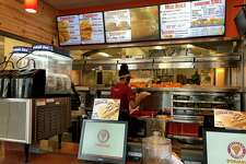 The Popeyes on 448 West Main St. in Stamford has received hundreds of orders for the new chicken sandwiches the Louisiana-style fast-food restaurant has promoted in the last weeks that has lead to Twitter fights with other large fast-food companies like Chick-fil-A.