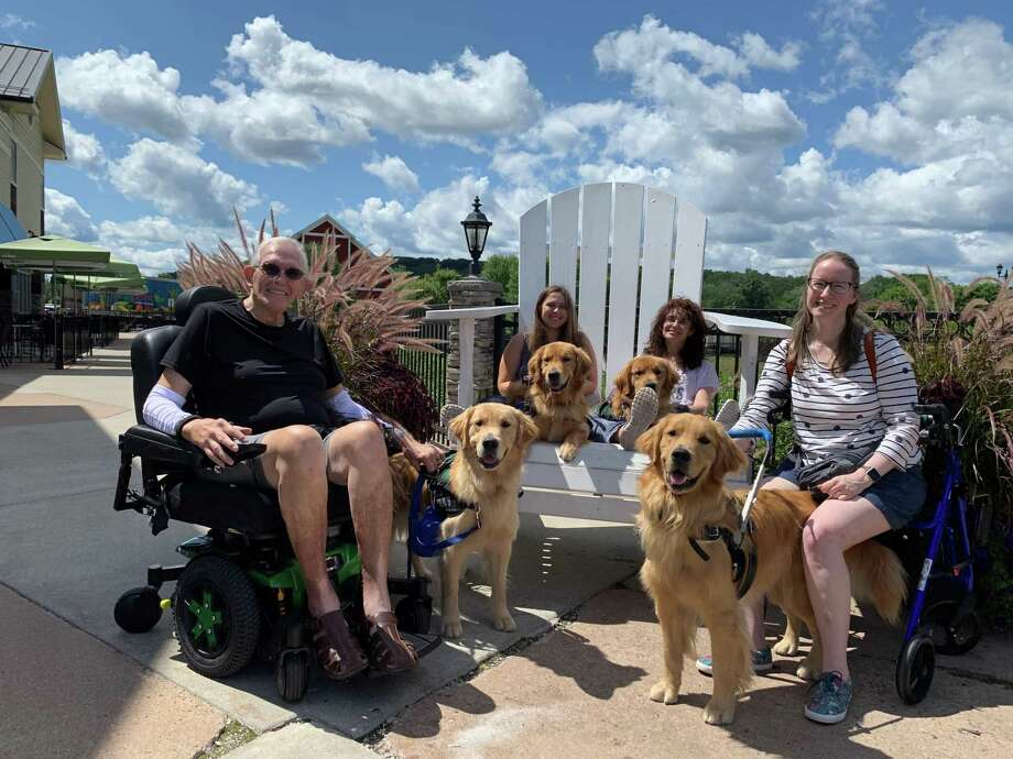 Four ECAD clients graduated with their service dogs Aug. 14. Client Kelly Wahle is pictured with her dog Bene. Photo: Contributed Photo