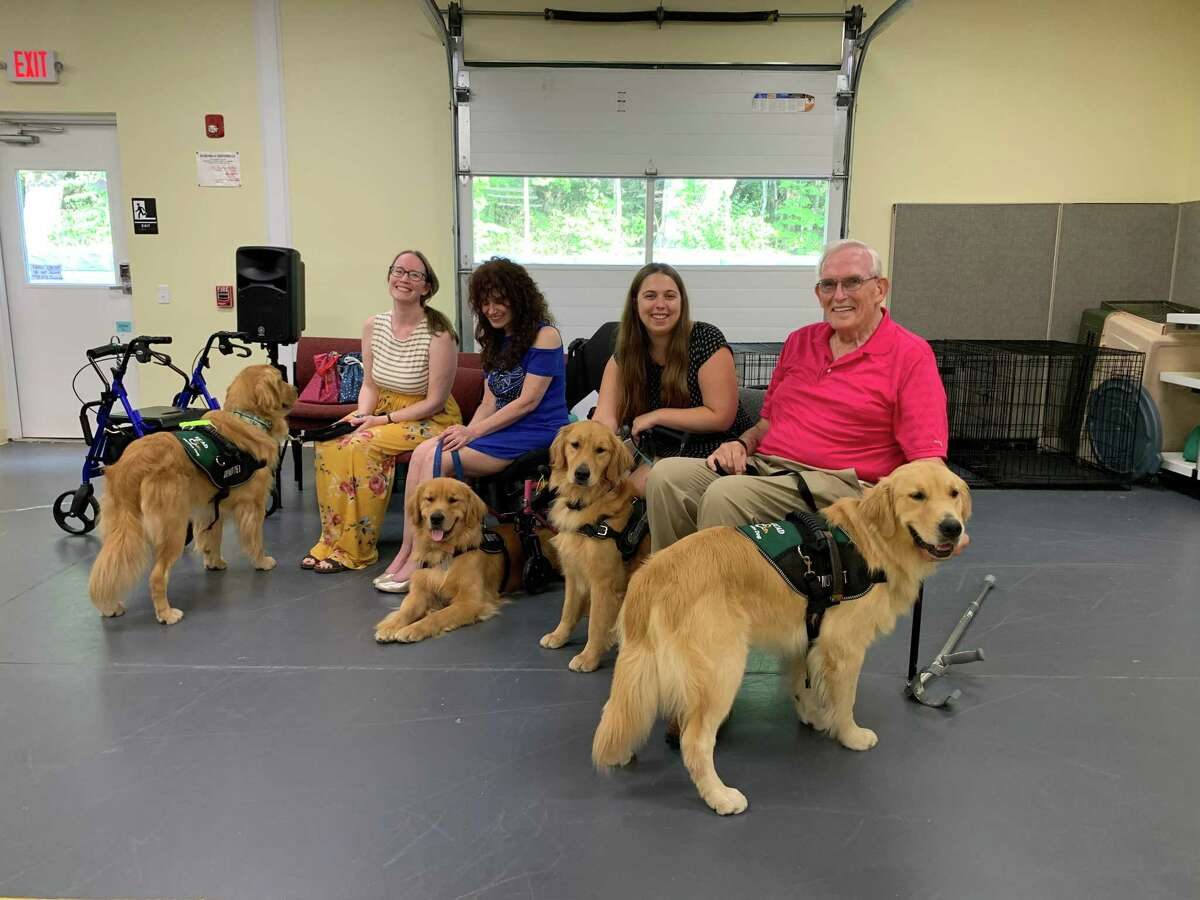 Four ECAD clients graduated with their service dogs Aug. 14. Client Kelly Wahle is pictured with her dog Bene.