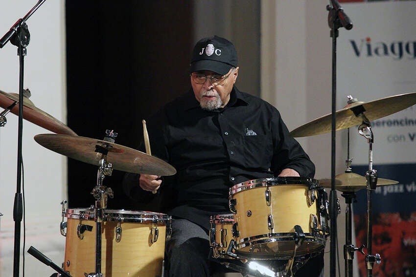In this July 19, 2019, photo provided by Giuseppe Iazzolino, drummer Jimmy Cobb from the Jimmy Cobb Trio performs with (not seen) Massimo FaraA2 and Paolo Benedettini at the Peperoncino Jazz Festival, in Catrovillari, a village in Calabria, Italy. Cobb, the only surviving musician who performed on Miles Davisa€™ jazz masterpiece a€œKind of Bluea€ is still keeping time as the iconic recording marks its 60th anniversary. (Giuseppe Iazzolino via AP)