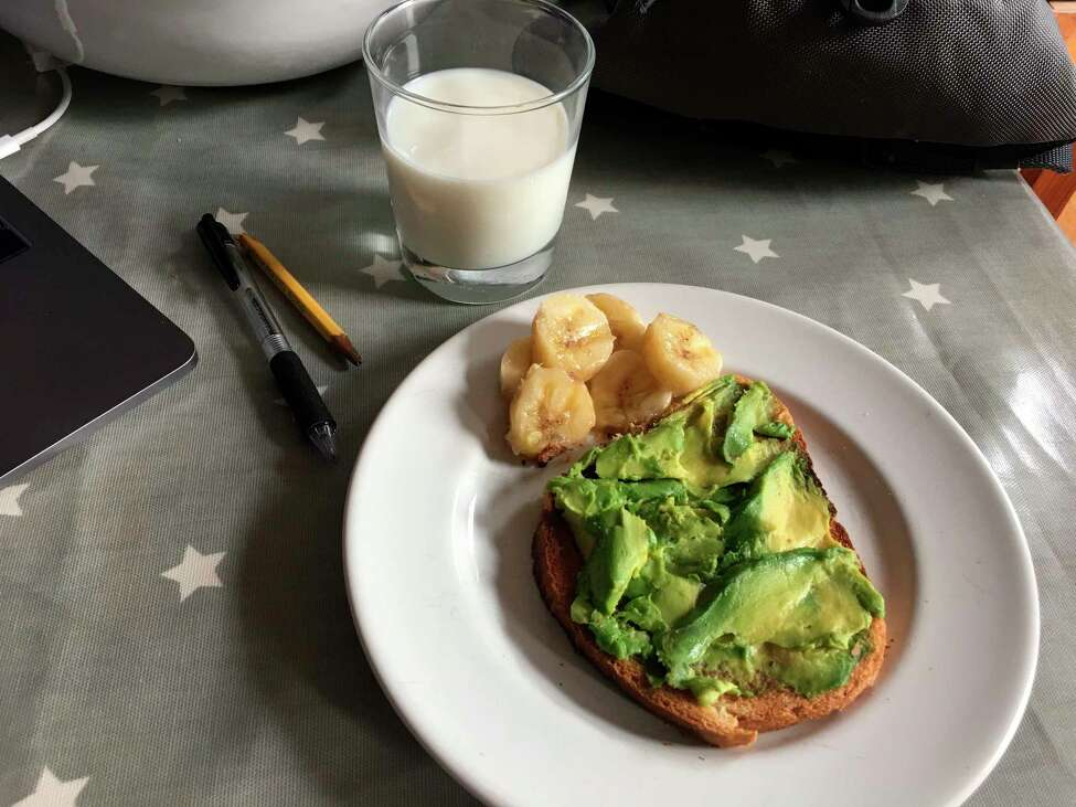 Avocado toast, banana and a glass of milk on a table in the Brooklyn borough of New York. Whole grain toast with avocado is a fast but nutritious school-morning breakfast, and parents can add a hard-boiled egg for extra protein. (Melissa Rayworth via AP)