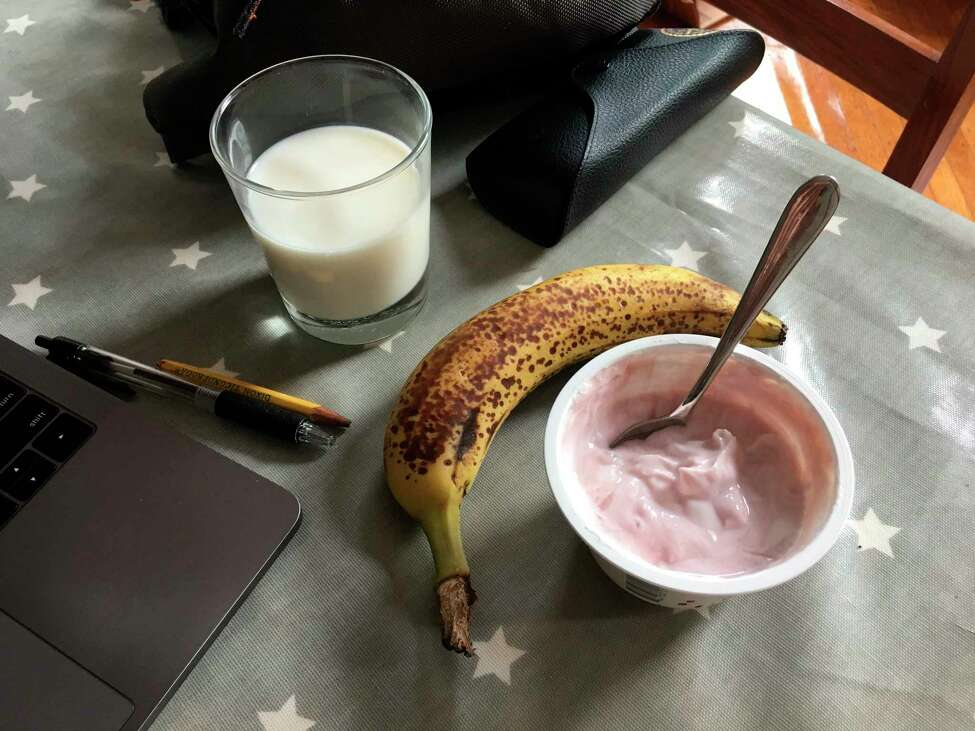 Yogurt and a banana with a glass of milk on a table in the Brooklyn borough of New York. Even kids who don't want a full breakfast on school mornings may have room for a quick cup of yogurt and a piece of fresh fruit. (Melissa Rayworth via AP)