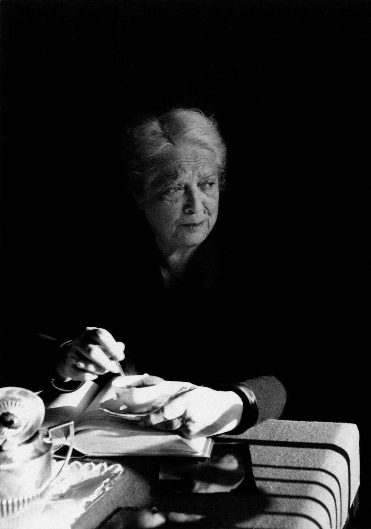 Italian food scholar Ada Boni sits at a table drinking coffee in 1960.