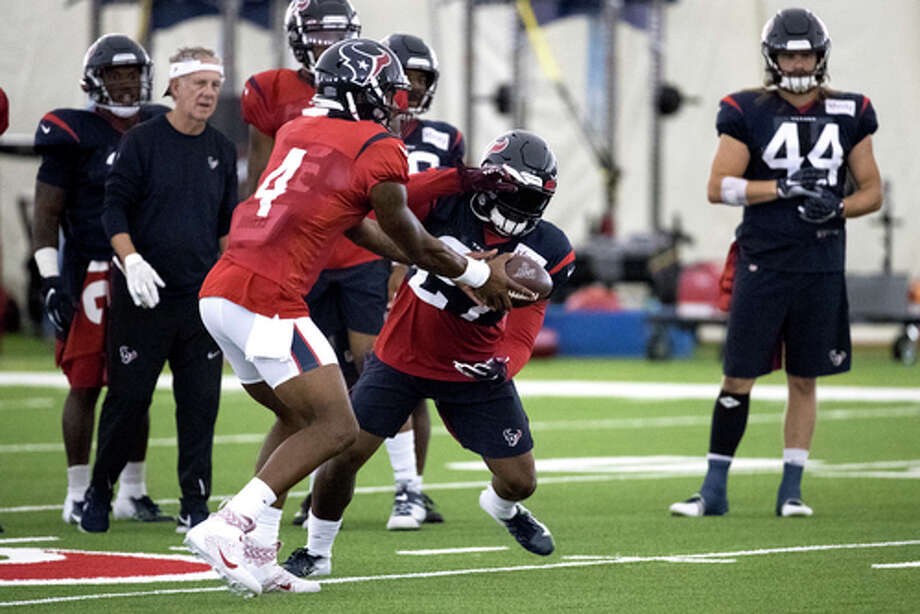 PHOTOS: Texans vs. Patriots Houston Texans quarterback Deshaun Watson (4) hands the ball off to running back Duke Johnson (27) during training camp at the Methodist Training Center on Wednesday, Aug. 21, 2019, in Houston. >>>Look back at photos from the Texans' win over the Patriots on Sunday night ... Photo: Brett Coomer, Staff Photographer / © 2019 Houston Chronicle