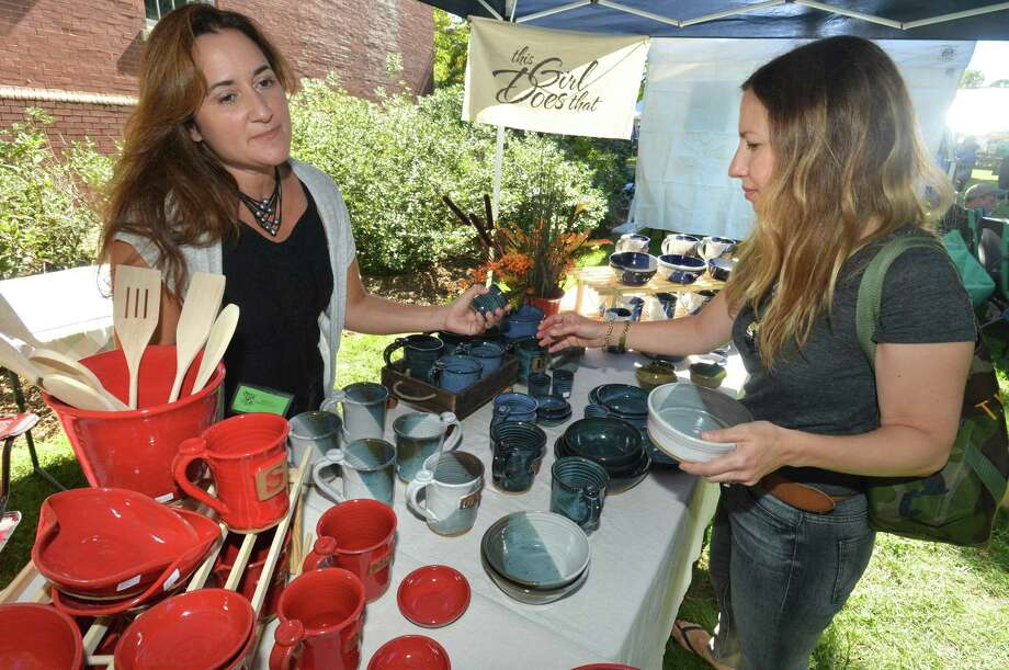 Tara White, from Trumbull, buys a few peices and some ceramic bowls from Krista Verbitsky, who hand makes them in her Trumbull pottery studio, This Girl Does That, during the 2018 Trumbull Arts Festival. The event returns September 15. Photo: Alex Von Kleydorff / Hearst Connecticut Media File Photo