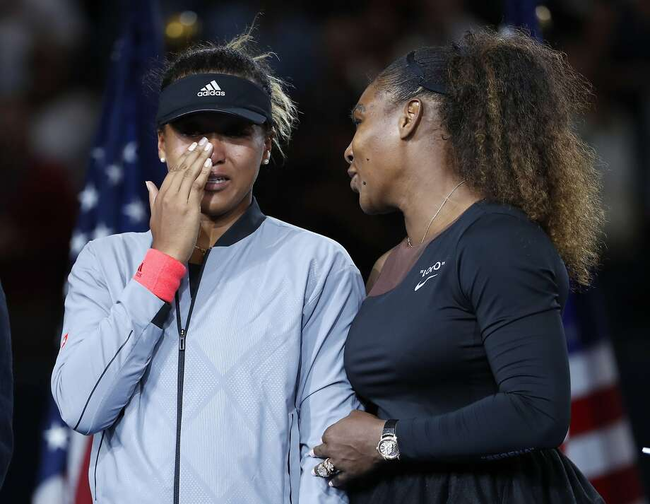 Naomi Osaka's terrific performance was largely ignored amid the chaos that enveloped Arthur Ashe Stadium after Serena Williams (right) argued with chair umpire Carlos Ramos. Photo: Adam Hunger / Associated Press
