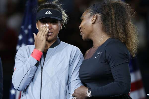 FILE - In this Sept. 8, 2018, file photo, Serena Williams talks with Naomi Osaka, of Japan, after Osaka defeated Williams in the women's final of the U.S. Open tennis tournament in New York. The tenor of the final between Williams and champion Osaka, whose terrific performance was largely ignored amid the chaos that enveloped Arthur Ashe Stadium, began to shift after chair umpire Carlos Ramos warned Williams for receiving coaching signals. (AP Photo/Adam Hunger, File)