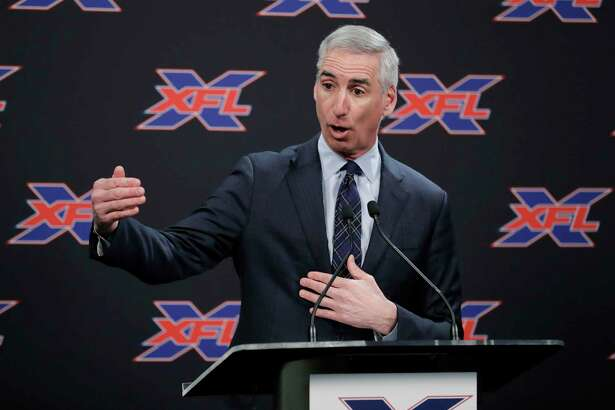 FILE - In this Feb. 25, 2019, file photo, XFL Football Commissioner Oliver Luck talks to reporters before introducing former NFL football quarterback Jim Zorn as the head coach for Seattle's XFL football team, in Seattle. Oliver Luck's first year as the XFL's commissioner has mostly been confined to the office and getting the league's framework set up. The next couple months though are what Luck refers to as the fun part of preparing for next year's return. (AP Photo/Ted S. Warren, File)