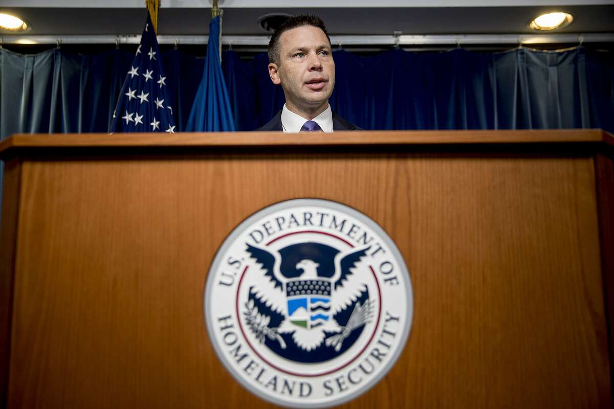 Acting Homeland Security Secretary Kevin McAleenan speaks about upcoming changes to the Flores ruling at a news conference at the Reagan Building in Washington, Wednesday, Aug. 21, 2019. (AP Photo/Andrew Harnik)