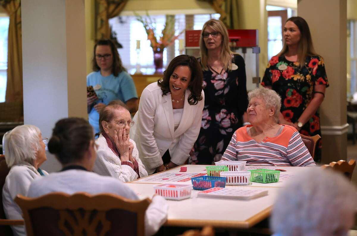 Democratic presidential candidate Sen. Kamala Harris, D-Calif., greets residents at Bickford Senior Living Center in Muscatine, Iowa.