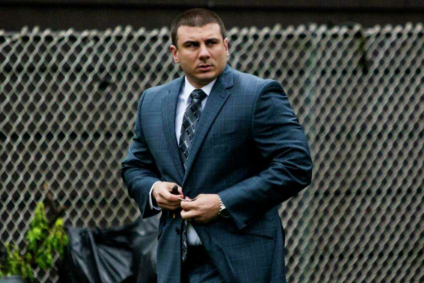 FILE - In this May 13, 2019, file photo New York City police officer Daniel Pantaleo leaves his house Monday, May 13, 2019, in Staten Island, N.Y. After five years of investigations and protests, New York City's police commissioner on Monday, Aug. 19, fired Pantaleo, an officer involved in the 2014 chokehold death of an unarmed black man whose dying cries of