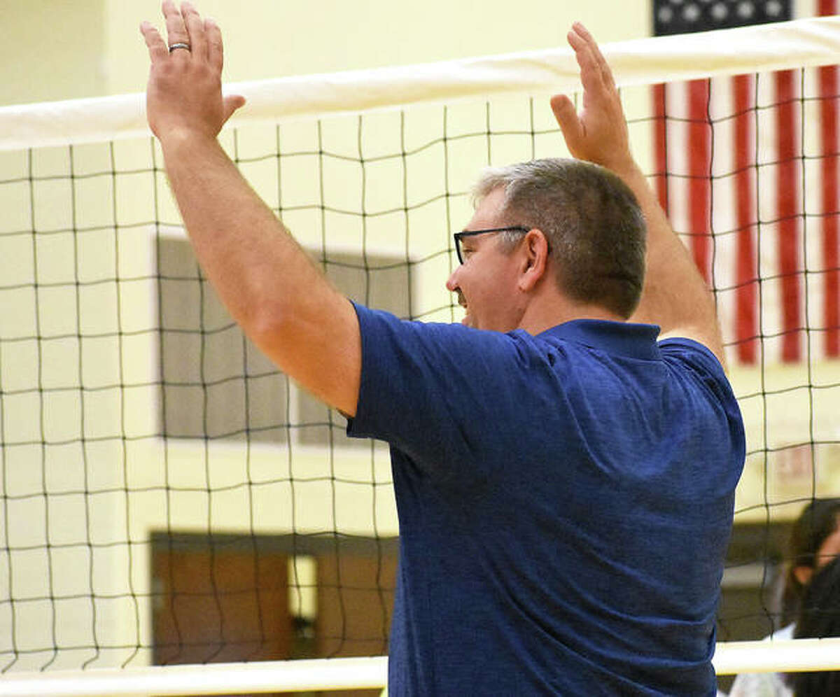 FMCHS coach Paul Vieth celebrates the final point of the scrimmage Tuesday at Meet the Griffins.