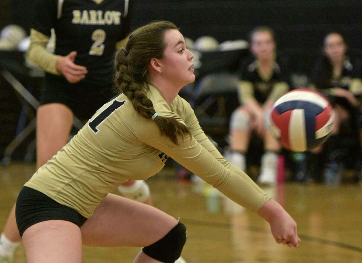 Barlow's Scotland Davis digs out a serve against Newtown on Oct. 24.
