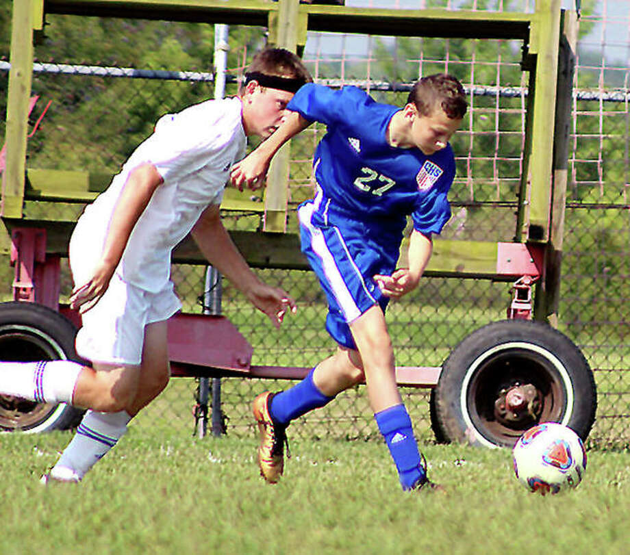 Levi Yudinsky of Carlinville, right, moves the ball in a game last season. Yudinsky scored four goals and added an assist last season as a freshman and returns this season. Photo: Pete Hayes | The Telegraph