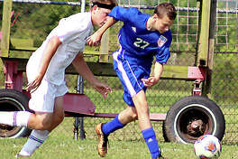Levi Yudinsky of Carlinville, right, moves the ball in a game last season. Yudinsky scored four goals and added an assist last season as a freshman and returns this season.