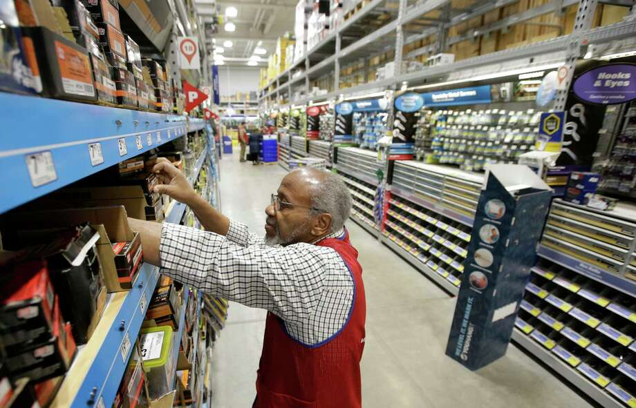 FILE - In this Feb. 23, 2018, file photo sales associate Larry Wardford, of Holliston, Mass., places items on selves at a Lowe's retail home improvement and appliance store, in Framingham, Mass. Lowe's Companies, Inc. reports financial results Wednesday, Aug. 21, 2019. (AP Photo/Steven Senne, File) Photo: Steven Senne / Copyright 2018 The Associated Press. All rights reserved.