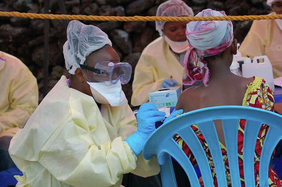 A girl receives a vaccine against Ebola from a nurse in Goma earlier this month.  The Congolese presidency said on Aug. 1 that cases of the deadly virus had been detected in the city of 2 million people. Photo: Augustin Wamenya /Getty Images / AFP or licensors