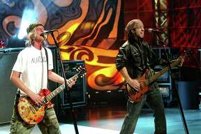 """Rock band Puddle of Mudd perform on """"The Tonight Show with Jay Leno"""" on January 16, 2004 at the NBC Studios, in Burbank, California. (Photo by Kevin Winter/Getty Images)"""
