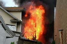 A two-alarm fire rips through a home at 1042 Iranistan Ave. in Bridgeport, Conn., on Wednesday, Aug. 21, 2019. Officials said the second floor of the home collapsed as crews were working to extinguish the flames, but no one was injured when it happened.