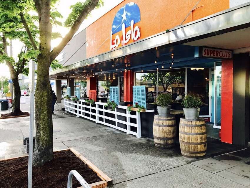La Isla: The lively Puerto Rican eatery in Ballard dispenses two key ingredients for a festive Cubano holiday: rum-based drinks, and the Cuban sandwich. They sprinkle it with house-made pickles, and of course a hefty dose of ham.