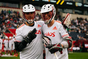 UAlbany alumni Miles Thompson, left, and Connor Fields of the Chaos of the Premier Lacrosse League. (Courtesy of Premier Lacrosse League)