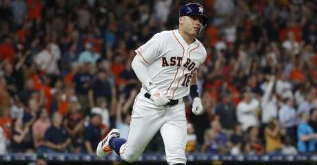 Houston Astros Aledmys Diaz (16) runs the bases after hitting a three-run home run during the third inning of an MLB baseball game at Minute Maid Park, Monday, July 22, 2019.