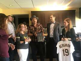 Oakland A's honor journalist Ron Bergman: from left to right, Anne Bergman, Adam Bergman, A's president Dave Kaval, A's vice president of communications Catherine Akers
