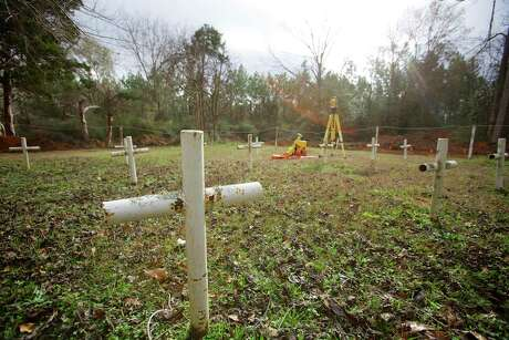 White crosses were planted in the 1990s to commemorate previously unmarked graves on the grounds of the Arthur G. Dozier School for Boys, in Marianna, Fla.