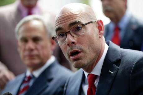 Speaker of the House Dennis Bonnen, right, finds himself embroiled in a political scandal after he was recorded by a right-wing activist. Bonnen allegedly offered press credential in exchange for the group targetting mostly moderate Republicans in the primary.