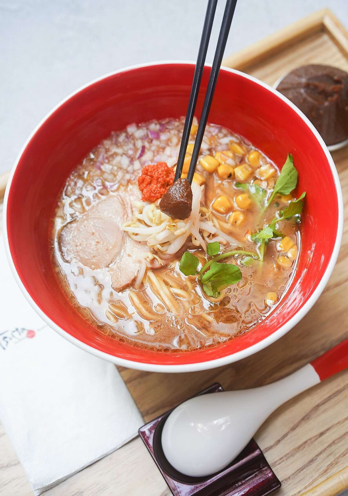 The miso ramen at Tsuta comes with char siu, bamboo shoots, corn, red onion and hot sauce.