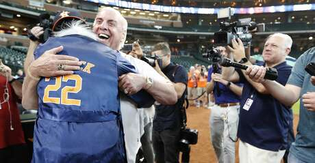 Ric Flair hugs Houston Astros right fielder Josh Reddick, who came out of the clubhouse wearing his Ric Flair attire during batting practice before the start  of an MLB game at Minute Maid Park, Wednesday, August 21, 2019.