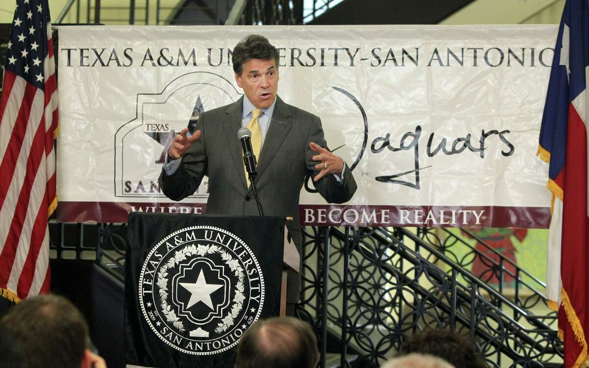 In this file photo, Texas Gov. Rick Perry (standing at lectern) speaks at a Tuesday May 15, 2012, press conference at Texas A&M University-San Antonio about affordable degree programs for college students in Texas. Texas A&M-San Antonio and other schools in Texas such as Tarleton State, UT Permian Basin and others announced $10,000 bachelor degree programs.