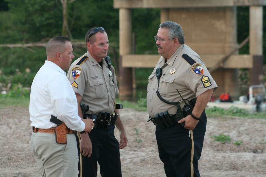 Capt. Rex Evans, Deputy James McQueen and Sgt. Brent Slaughter, representing the Liberty County Sheriff's Office, worked with the Tarkington, Hardin, North Liberty County and Cypress Lakes fire departments to coordinate a search for a missing 51-year-old man who is presumed to have drowned in the Trinity River at the SH 105 bridge in Moss Hill on Saturday, June 9. Photo: VANESA BRASHIER / The Advocate / The Advocate