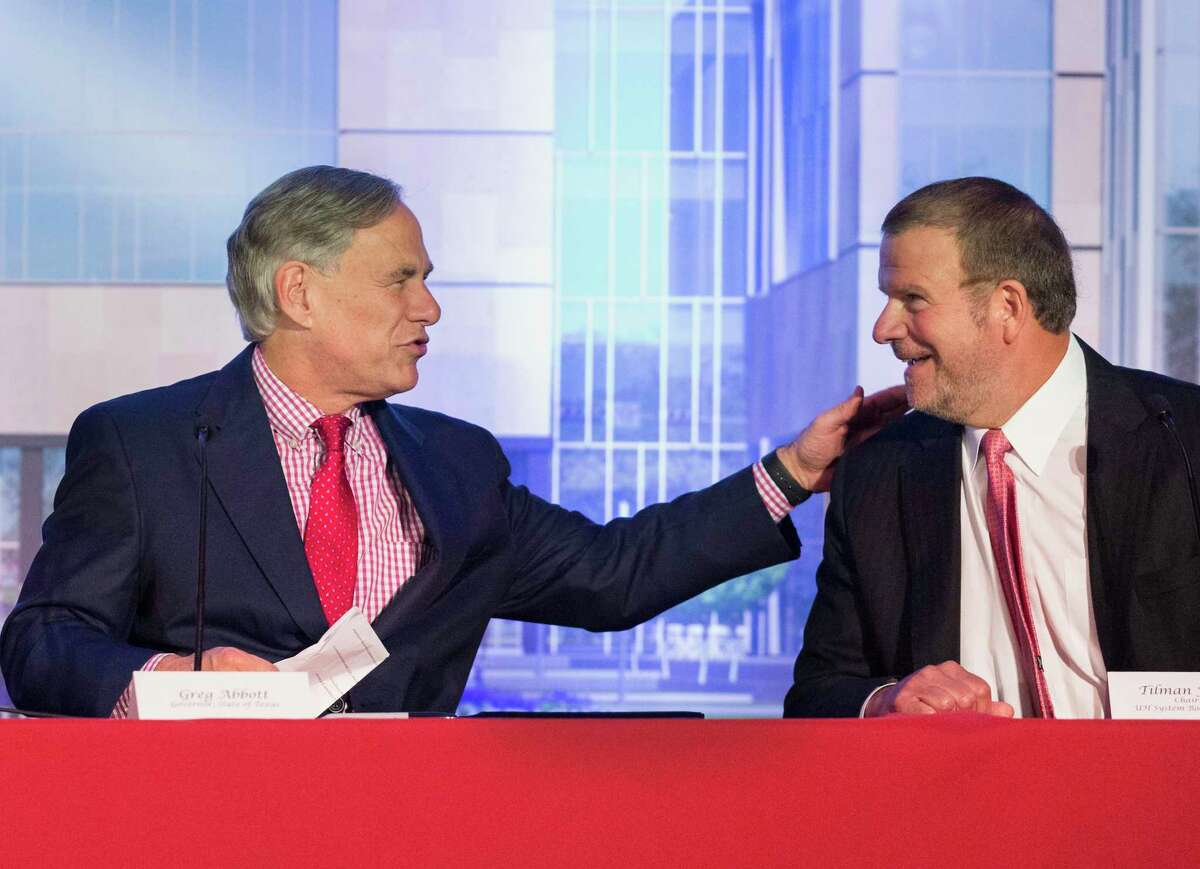 Gov. Greg Abbott and Tilman Fertitta, University of Houston System Board of Regents chairman, greet each other at the University of Houston College of Medicine bill signing ceremony on Wednesday, Aug. 21, 2019, in Houston. Abbott, who officially signed HB826 bill into law in May, signed the bill again during the ceremony.