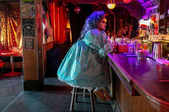 Vivvyanne ForeverMORE sits at the bar of The Stud before emceeing Drag Alive July 26, 209. The Stud has been a staple of queer nightlife for over 50 years and is owned and operated by an 18-person worker-owner cooperative of which Vivvyanne ForeverMORE is one of.