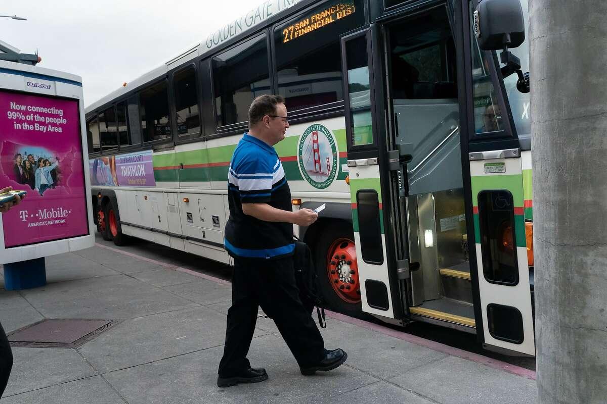 Shaun Ralston takes a bus from the San Rafael Transit Center.