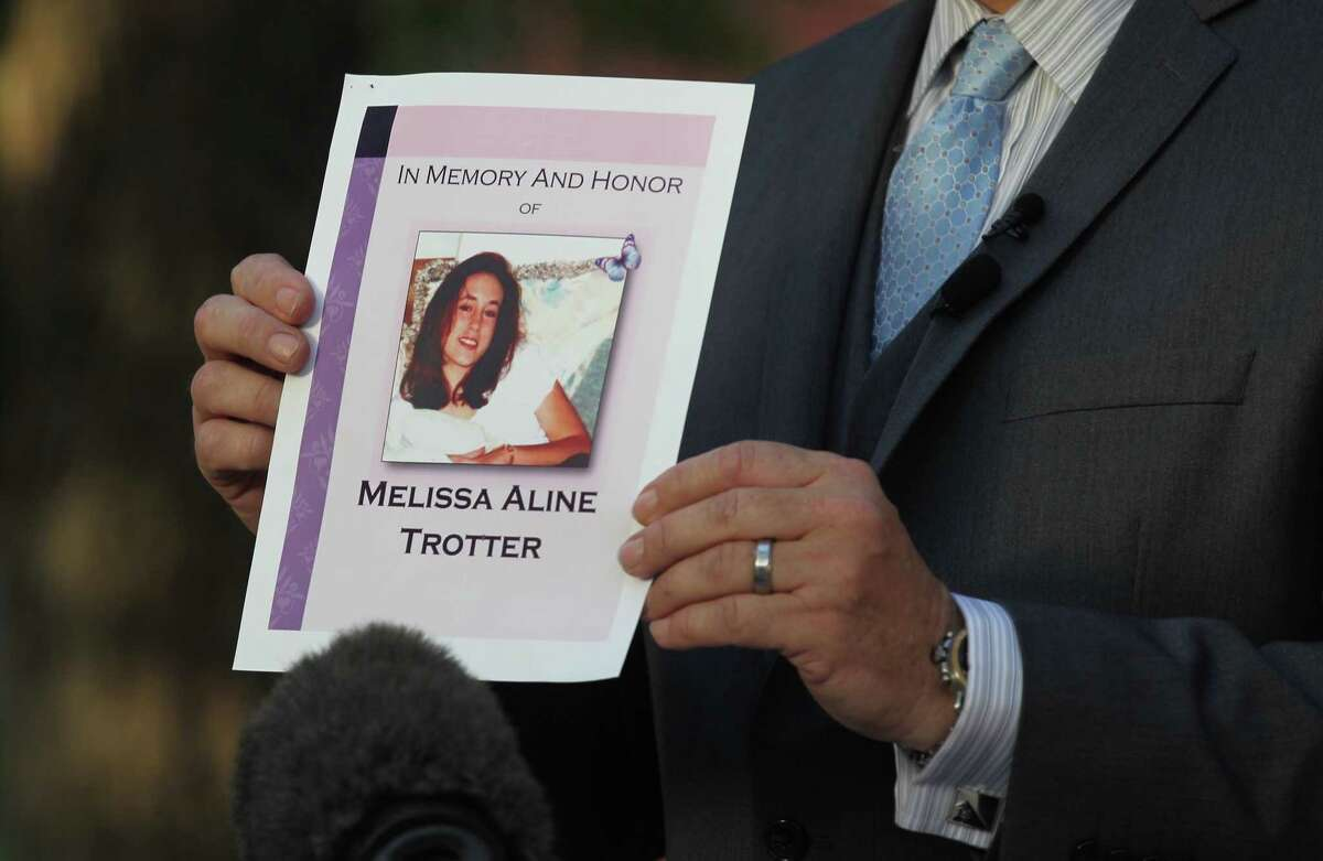"""An image of Melissa Trotter is held up as Jeremy Desel, with the Texas Department of Criminal Justice, reads a statement by her parents, Sandy and Charles Trotter, after their daughter's killer, Larry Swearingen, was executed at the Huntsville Unit Texas State Penitentiary Huntsville """"Walls"""" Unit, Wednesday, Aug. 21, 2019, in Huntsville. Swearingen was sentenced to die nearly two decades ago after a jury convicted him of raping and murdering 19-year-old Montgomery County college student Melissa Trotter, then dumping her body in Sam Houston National Forest."""
