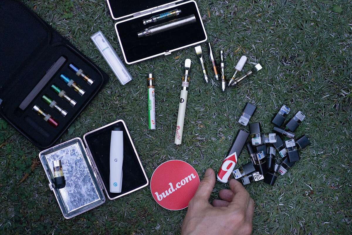 Justin Hall lays out a collection of vaping products on Wednesday, Aug. 21, 2019, in San Francisco, CA.