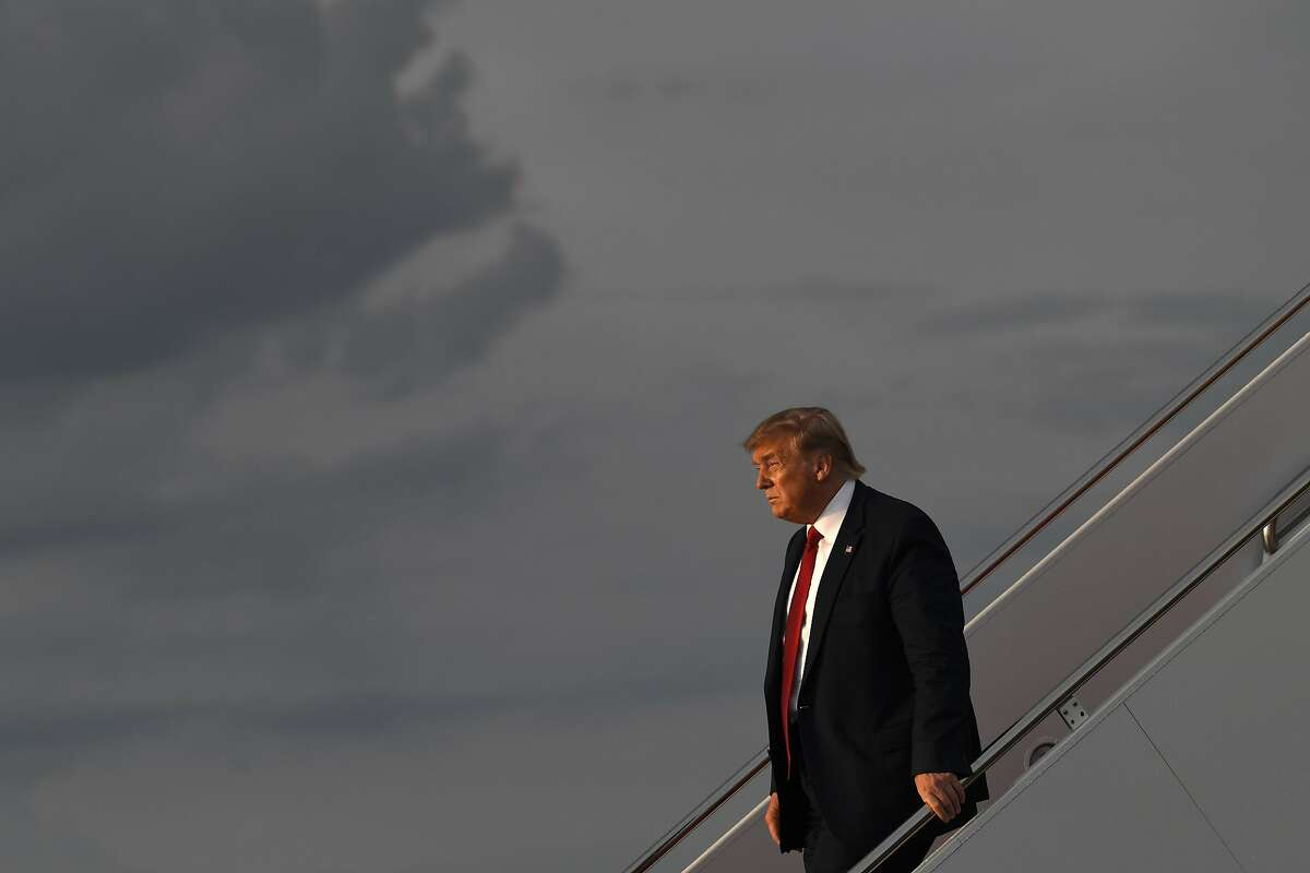 President Donald Trump walks down the steps of Air Force One at Andrews Air Force Base in Md., Wednesday, Aug. 21, 2019. Trump is returning from Louisville, Ky., where he spoke to the American Veterans (AMVETS) 75th National Convention. (AP Photo/Susan Walsh)