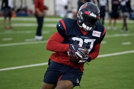 Texans running back Duke Johnson turns upfield after making a catch during Wednesday's training camp session.