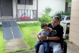 Jessie Avalos holds his grandson Jadiel Miranda, 2, as he and fellow cancer patients being treated at a Medical Center of Southeast Texas facility gather with Dr. Triptesh Chaudhury and lawyer Gary Riebschlager at Avalos' home for a press conference regarding the interruption of their treatment and future legal proceedings. The center closed its doors without notification to patients or Dr. Chaudhury. They were mid-treatment and have since been denied access to their medical records to pursue care elsewhere. Photo taken Wednesday, August 21, 2019 Kim Brent/The Enterprise